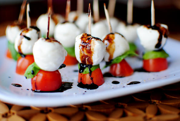 Caprese skewers with balsamic drizzle on a plate