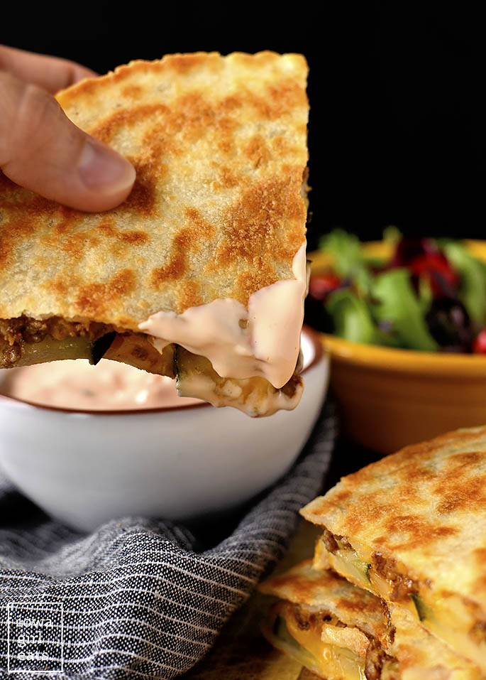 Cheeseburger Quesadilla dunked into special sauce
