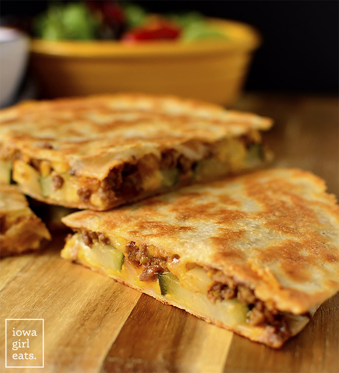 Sliced Cheeseburger Quesadillas on a cutting board