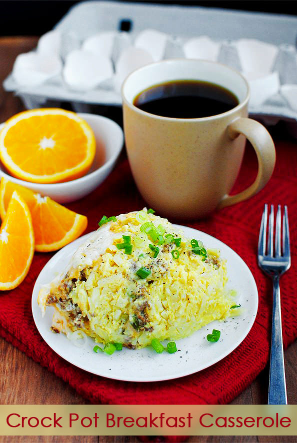 Crock Pot Breakfast Casserole is the perfect gluten-free breakfast recipe to feed a hungry crowd. Cheesy, hearty and so delicious! | iowagirleats.com