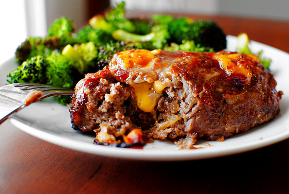 Mini BBQ Cheddar Meatloaves are studded with melty cheddar cheese and sweet BBQ sauce. This easy, gluten-free dinner recipe will be a hit with the whole family!