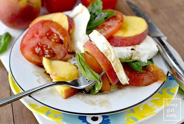Peach Caprese Salad is a summery-sweet twist on classic Caprese Salad. Serve as a light summer supper or a side dish to any grilled dinner! | iowagirleats.com