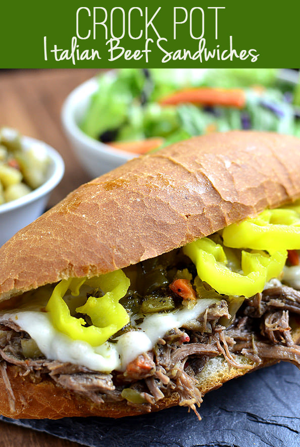 Crock Pot Italian Beef Sandwiches are a 5-ingredient crock pot recipe version of the popular hot sandwich recipe. This easy dinner recipe is a crowd-pleaser! | iowagirleats.com