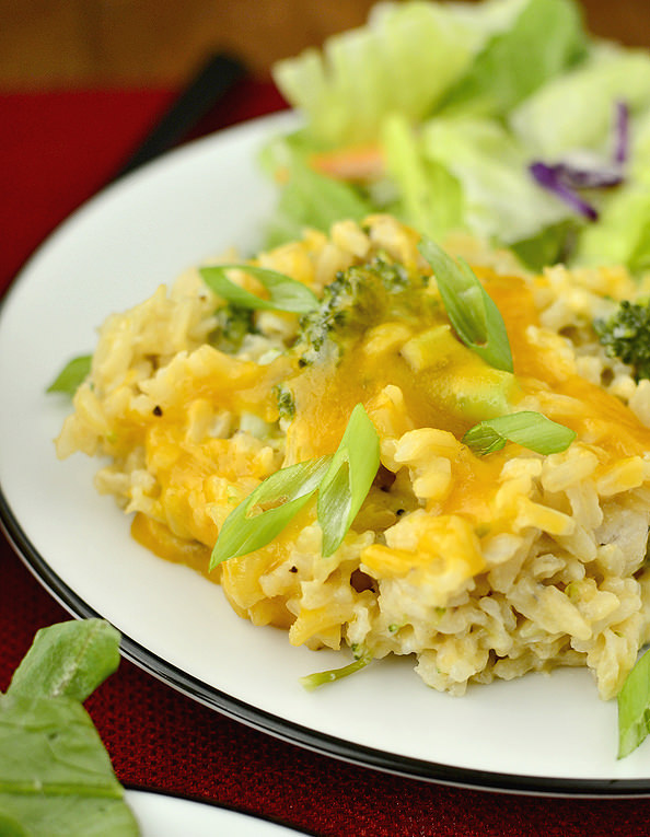 side view of plate of healthy cheesy chicken and broccoli rice casserole
