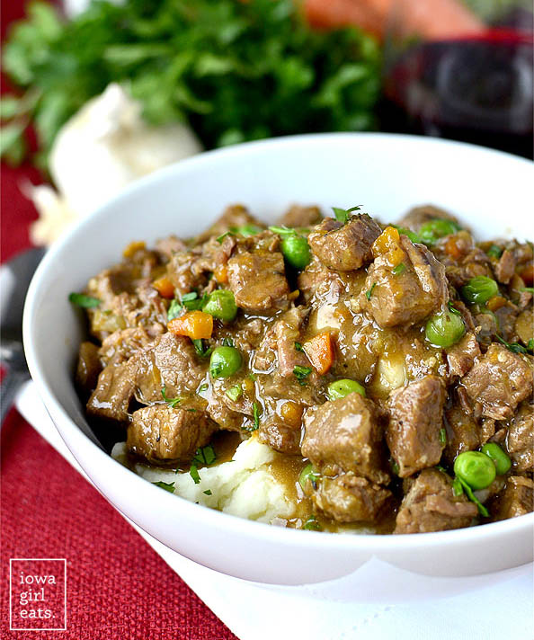 Closeup photo of bowl of Beef Stew over mashed potatoes