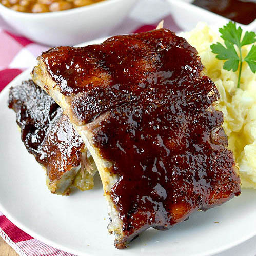 Easy Baked Ribs - Fall Apart Tender and Made in the Oven!
