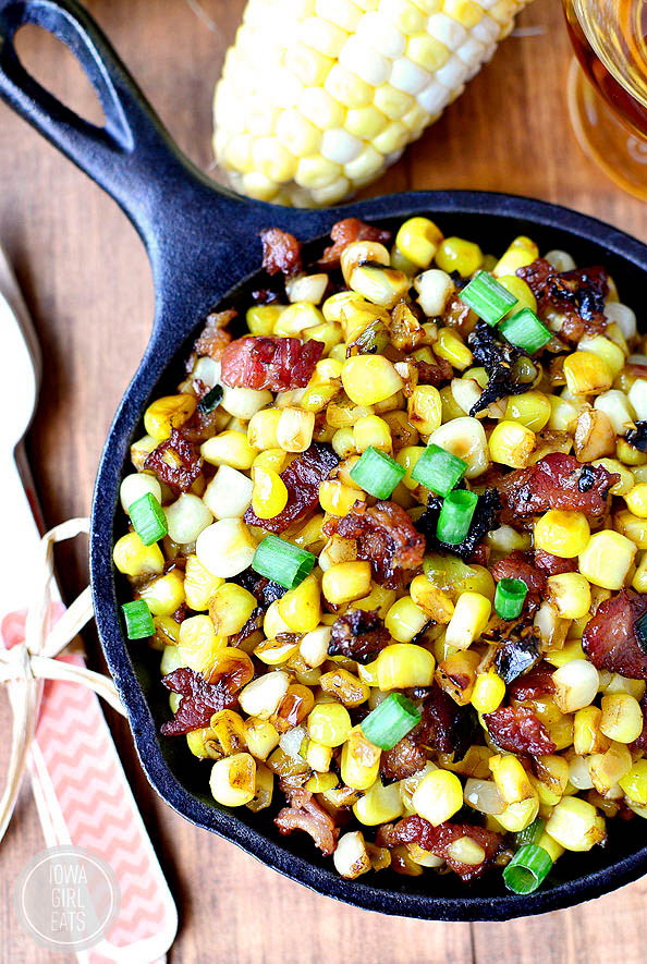 overhead photo of brown butter sweet corn with maple bourbon bacon in a skillet