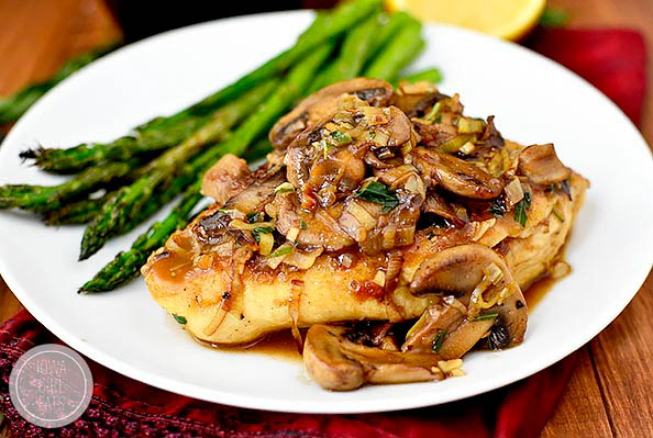 saucy leek and mushroom chicken on a plate