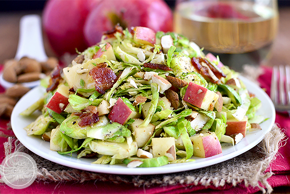 Apple, Almond, Bacon and Brussels Sprouts Salad with warm bacon dressing is a fresh and spring salad with lots of crunch! #glutenfree | iowagirleats.com