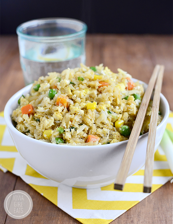 Bowl of fried rice with chop sticks
