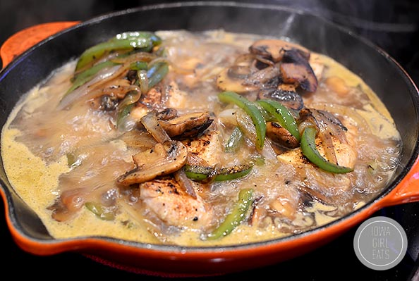 Saucy Smothered Southern Chicken with Parmesan Grits is a quick and mouthwatering, healthy yet decadent-tasting dinner! #glutenfree   iowagirleats.com