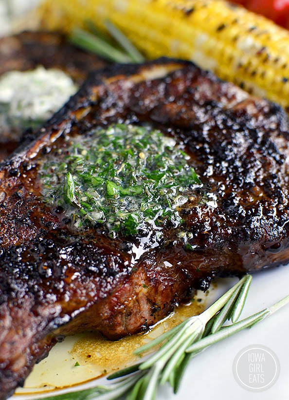 Grilled steak with herb butter melted on top