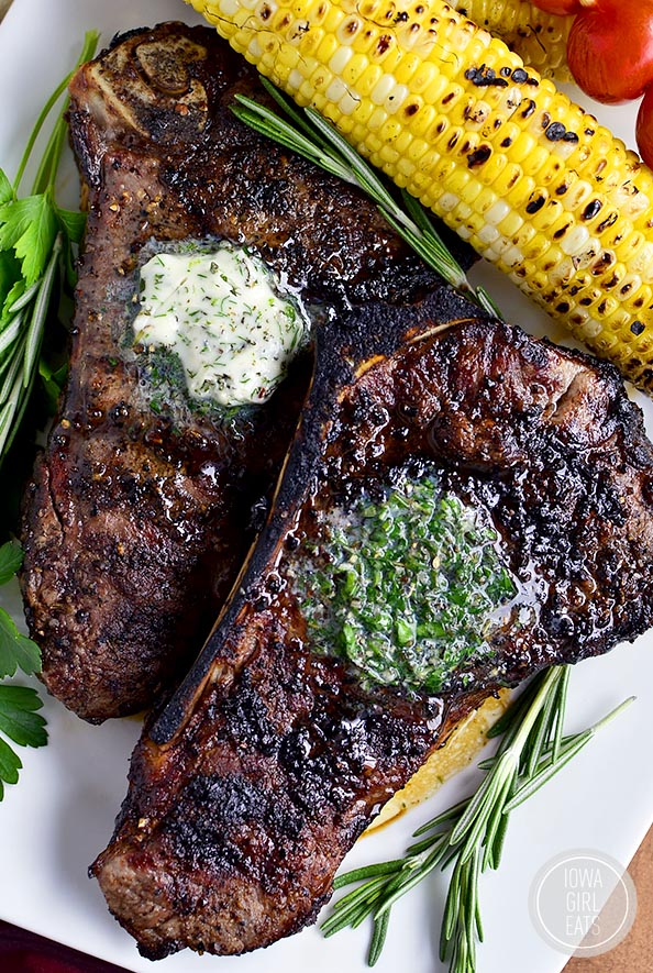 Two perfect grilled steaks with herb butter