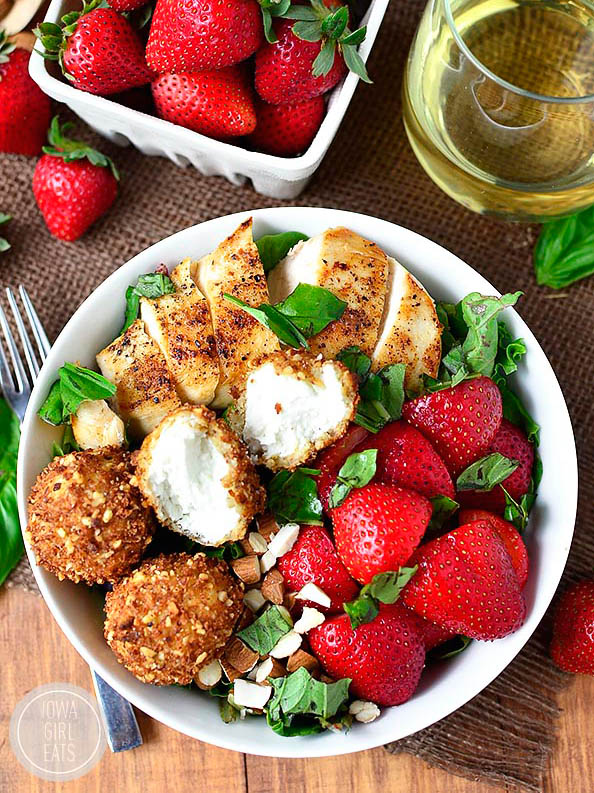 overhead photo of fried goat cheese balls on a strawberry basil chicken salad