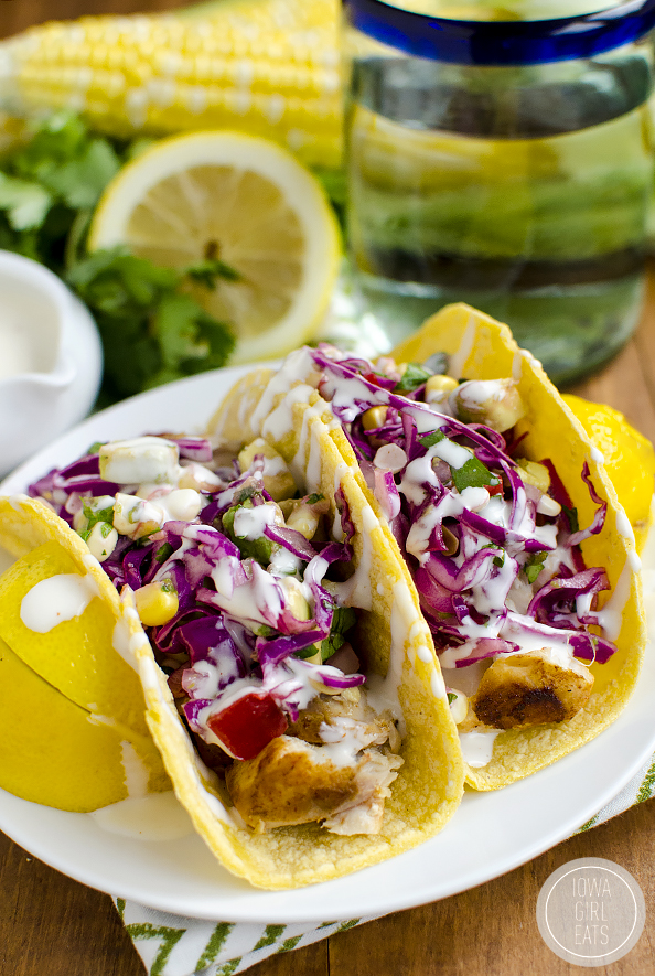 Fish Tacos with Avocado Sweet Corn Slaw are fresh and full of flavor. Feel like you're on vacation right at home! | iowagirleats.com