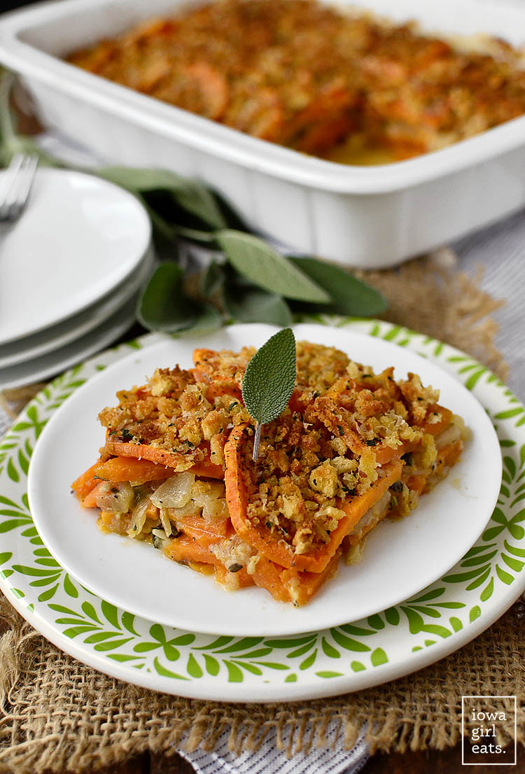 Skinny Sweet Potato Gratin tastes decadent yet is light, healthy, gluten-free and easily made dairy-free. A great swap for heavy, cream-laden holiday dishes! | iowagirleats.com