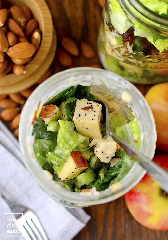 Apple, CrApple, Cranberry, Almond Mason Jar Salads with homemade Greek Yogurt Poppy Seed Dressing are a fresh, healthy, and easy make-ahead lunch option! | iowagirleats.comanberry, Almond Mason Jar Salads with homemade Greek Yogurt Poppy Seed Dressing are a fresh, healthy, and easy make-ahead lunch option! | iowagirleats.com