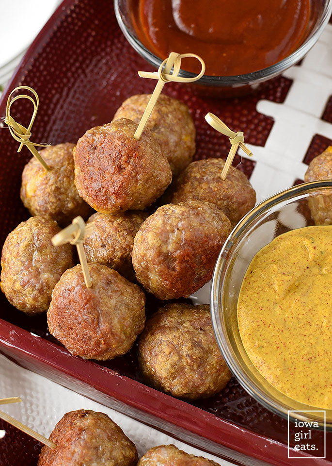 Cheddar Brat Meatballs are homemade bratwurst stuffed with gooey cheddar cheese. Serve with three,
