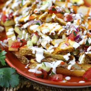 Chicken Shawarma Fries with Mediterranean Salsa and Garlic Sauce