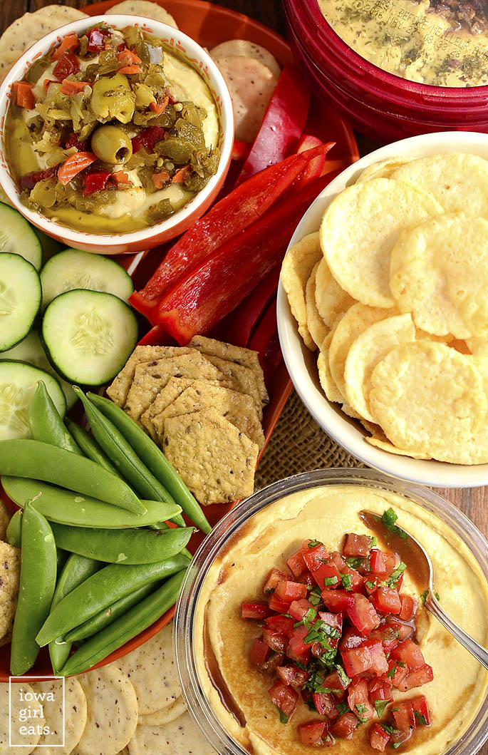 Shortcut Bruschetta Hummus is a quick and easy way to jazz up store-bought hummus. This fresh and healthy snack is absolutely delicious! | iowagirleats.com