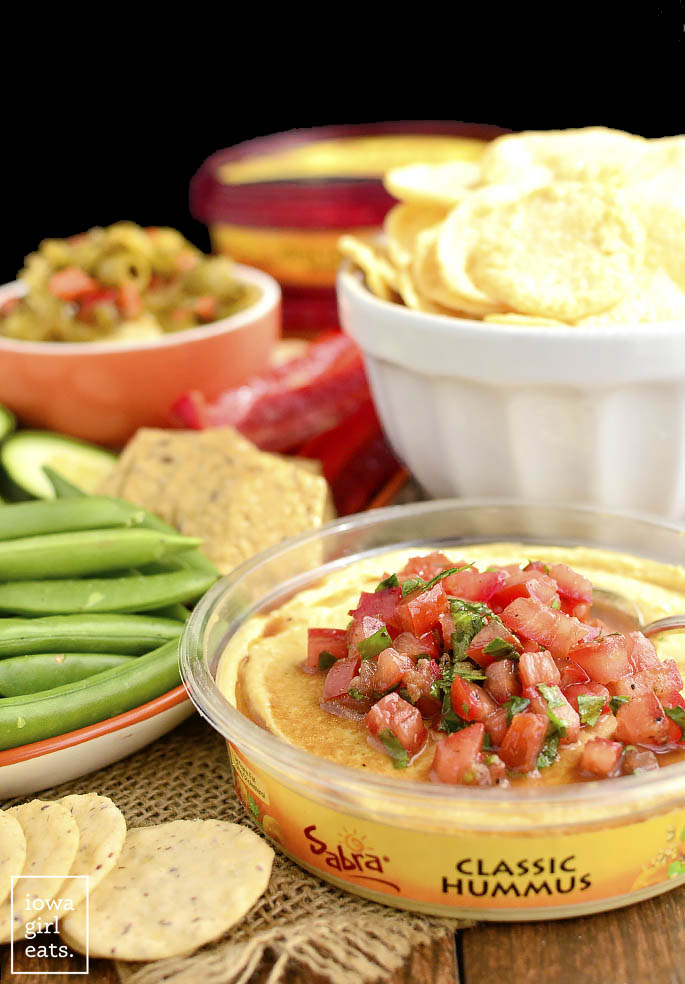 Bruschetta Hummus is a quick and easy way to jazz up store-bought hummus. Fresh, healthy, and absolutely delicious! | iowagirleats.com