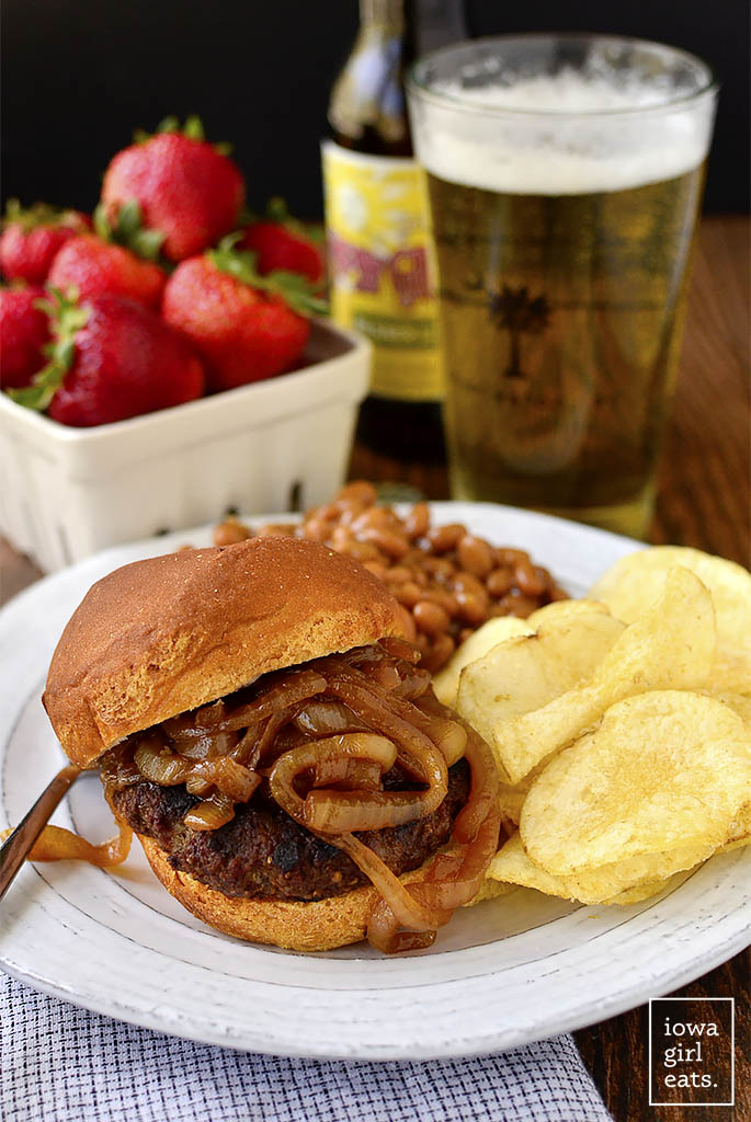 Homemade Brat Burgers with Gluten-Free Beer-Braised Caramelized Onions are homemade brat patties (just pork and spices,) topped with luscious, gluten-free beer-spiked onions. You'll be making this easy grilling recipe all summer long!   iowagirleats.com