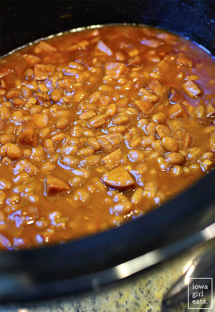 Crock Pot Baked Beans is a rich, sassy, and super simple crock pot recipe that's sure to become a summertime side dish staple at your house! | iowagirleats.com