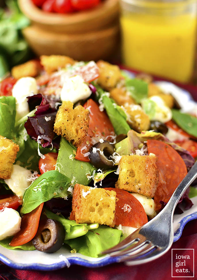 Pizza Salad with Homemade Gluten-Free Croutons is a fresh and filling entree salad packed with pizza flavor. Homemade gluten-free croutons add a satisfying crunch. | iowagirleats.com