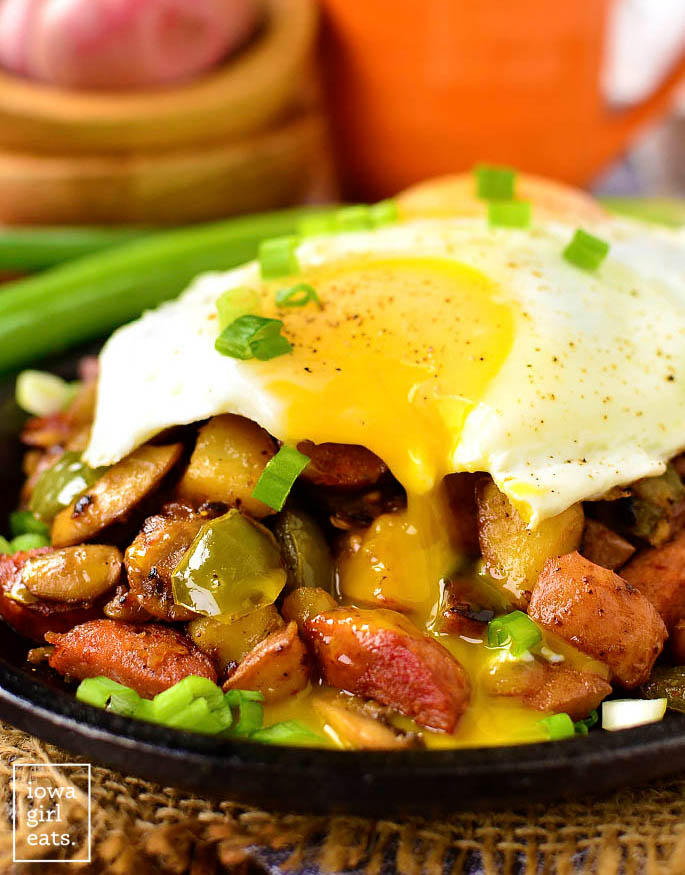 cajun style hash with a drippy egg on top