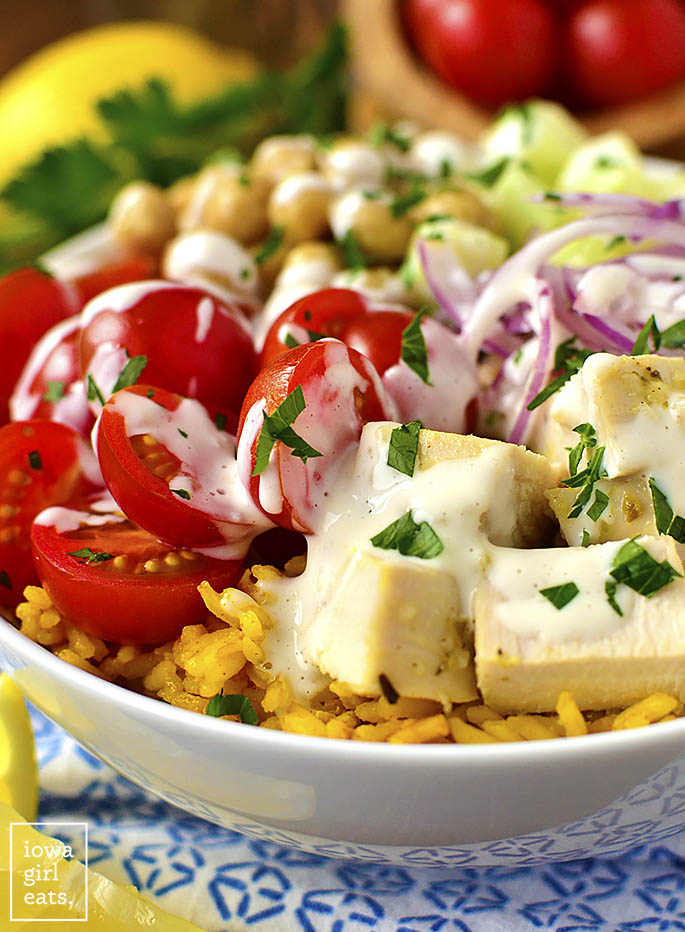 Mediterranean Chicken and Chickpea Bowls with Yellow Rice are healthy, gluten-free, and feature pops of fresh Mediterranean flavor like lemon and garlic. | iowagirleats.com