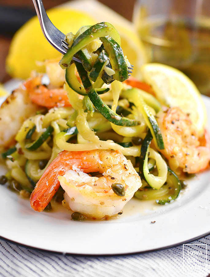 fork twirling zucchini noodles with shrimp