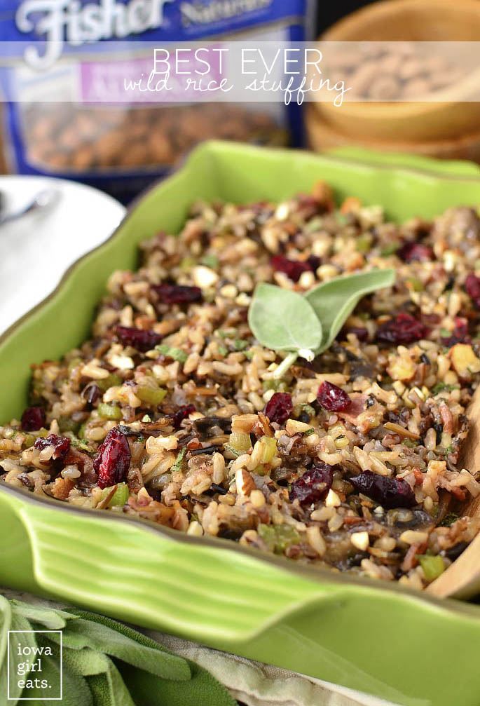 Best Ever Wild Rice Stuffing is full of fall flavors like herbs, bacon, mushrooms, parmesan, dried cranberries, almonds, and garlic. A delicious side for the holidays! | buzzpur.info
