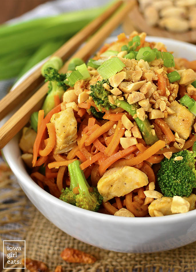 Thai Peanut Chicken and Sweet Potato Noodles are a healthy and gluten-free twist on your favorite Thai takeout order. Easy, colorful, and delicious! | iowagirleats.com