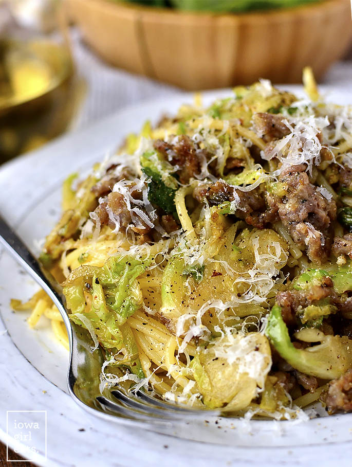 20 Minute Sausage, Brussels Sprouts and Parmesan Pasta will be on the table in absolutely no time. A filling and flavorful gluten-free dinner recipe! | iowagirleats.com