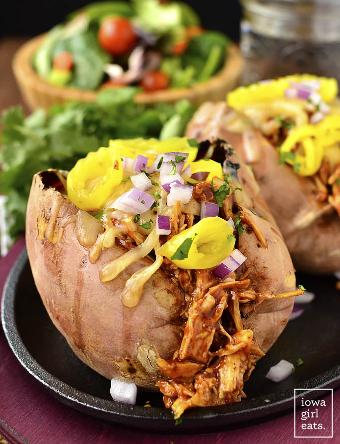BBQ Chicken Stuffed Sweet Potatoes call for just 5 main ingredients and are insanely delicious. Leftovers are just as tasty too! | iowagirleats.com