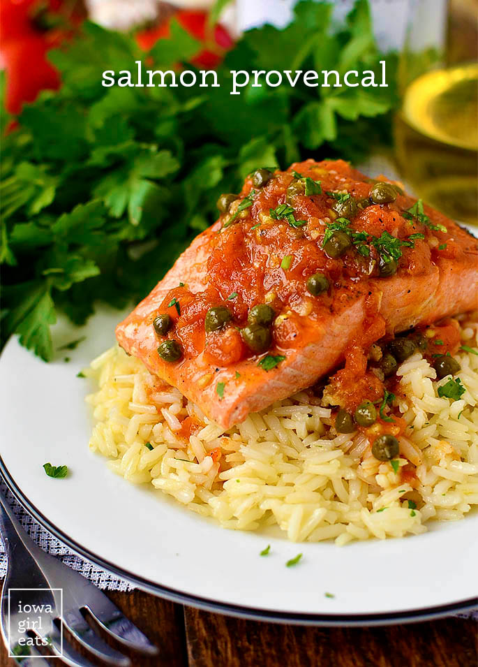filet of salmon with provencal sauce over cooked white rice