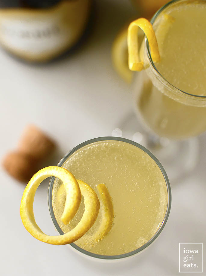 French 75 Champagne Cocktails are made with just four ingredients, no specialty liqueurs or mixers needed! Enjoy this delicious and bright champagne cocktail for any occasion. | iowagirleats.com
