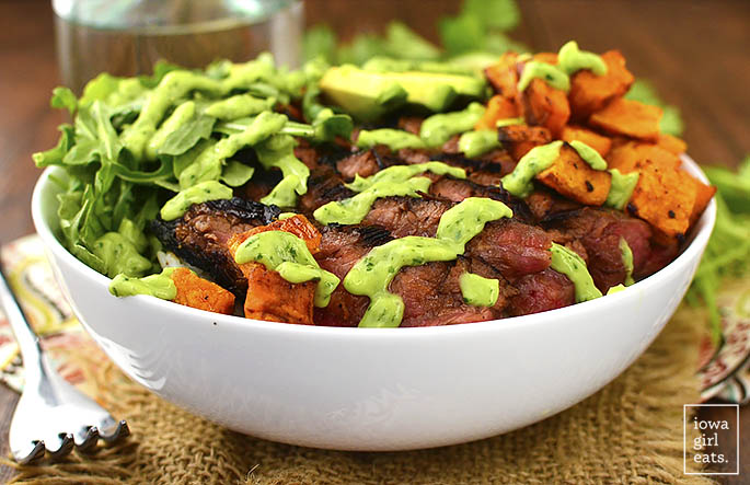 Steak and Avocado Roasted Sweet Potato Bowls are gluten-free, healthy and hearty. Everyone will love this complete meal in a bowl! | iowagirleats.com