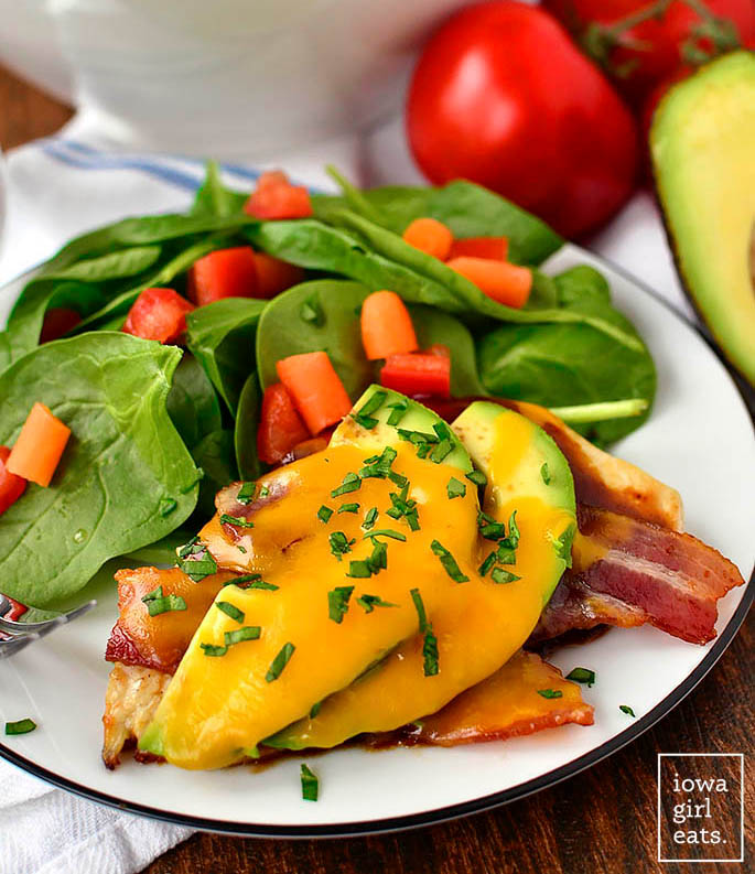 bbq bacon avocado cheddar chicken on a plate with a salad