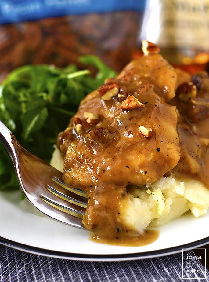 Maple Bourbon Pecan Chicken is sinfully delicious - you will lick your plate clean! This 1-skillet, gluten-free dinner recipe is ready in just 20 minutes. | iowagirleats.com