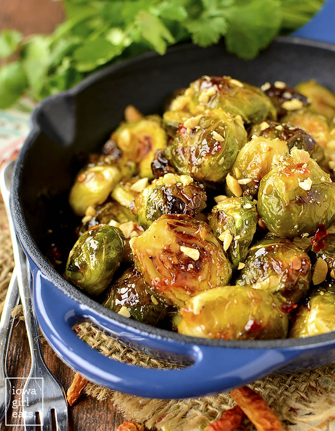 Dinner just got interesting! Sweet Chili Roasted Brussels Sprouts are simple yet so scrumptious. The perfect gluten-free side dish to liven up any ho hum meal. | iowagirleats.com