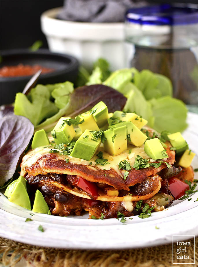 Mini Vegetarian Enchilada Stacks are perfectly proportioned and full of fresh vegetables, melty cheese, and savory enchilada sauce. A fun and delicious gluten-free dinner recipe! | iowagirleats.com