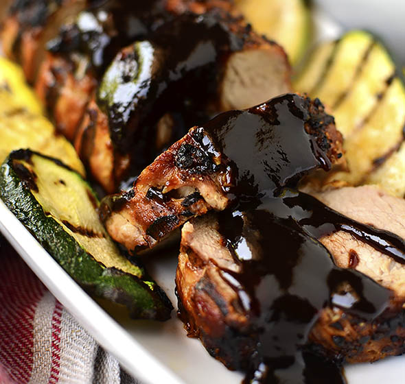 I'm sharing my tricks for achieving the most unbelievably juicy grilled pork tenderloin, which cooks in under 15 minutes. Pair with grilled vegetables for a filling and healthy dinner! | iowagirleats.com