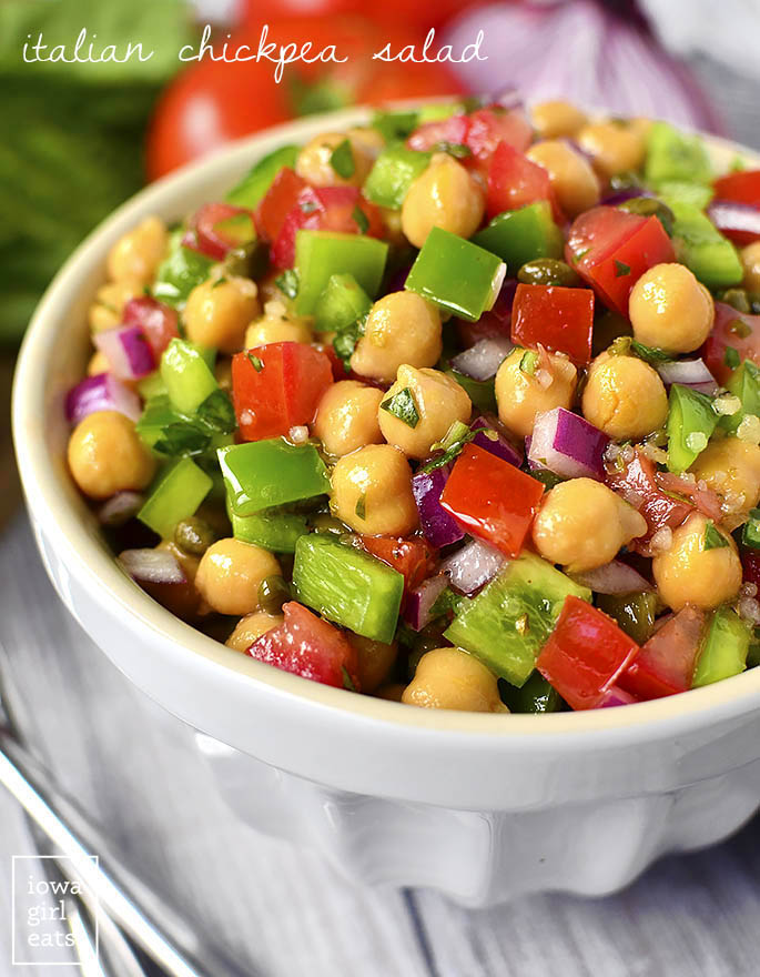 Italian Chickpea Salad is a simple, vegetarian salad recipe that's full of fresh and heaalthy ingredients. It's the perfect side dish for parties and potlucks! | iowagirleats.com