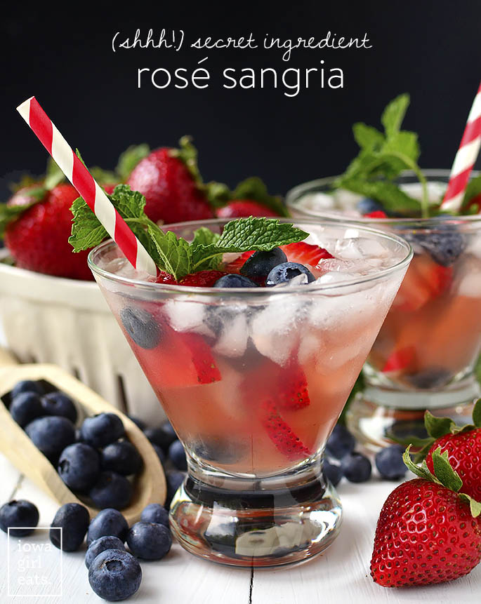 Secret Ingredient Rosé Sangria is the perfect drink to cool off with when temperatures start to rise. Not too sweet, and livened up by a secret ingredient! | iowagirleats.com