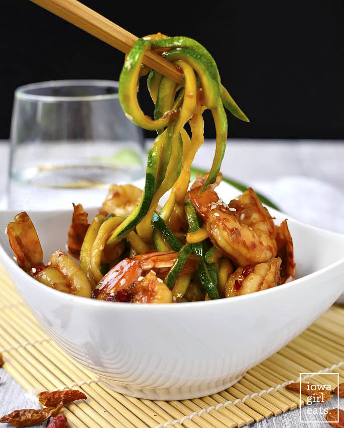 Sweet Chili Sesame Shrimp and Zoodles takes minutes to cook and is full of tongue-tingling flavor. This light and healthy gluten-free recipe calls for just 5 ingredients. | iowagirleats.com