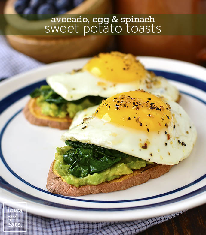 Sweet potato toasts on a plate topped with eggs and avocado