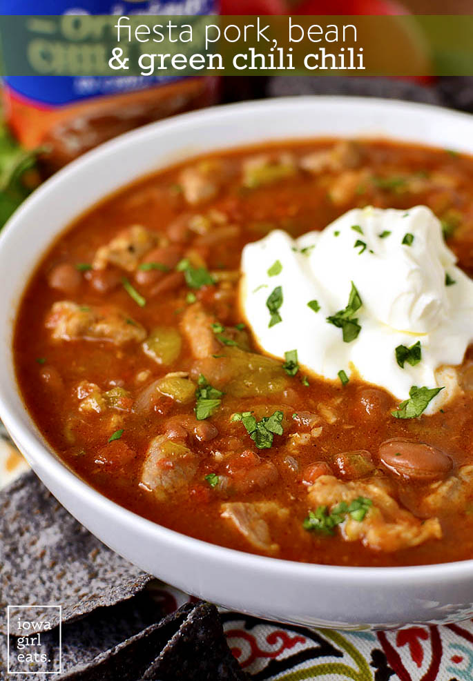 Fiesta Pork Bean and Green Chili Chili has just the right amount of kick, spice, and sass. This filling chili recipe is perfect for a cool fall nights, or game day, and leftovers just get better! | iowagirleats.com