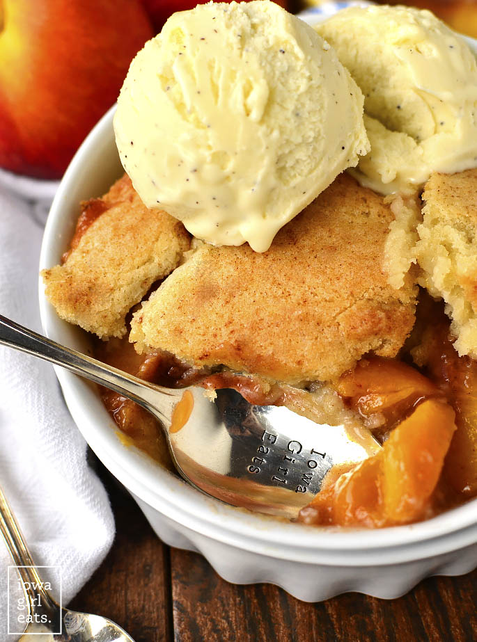 Sugar Cookie Peach Cobbler for Two is a cozy gluten-free dessert recipe that makes just enough for you and a friend. Made in just one bowl, it's a cinch to whip up! | iowagirleats.com