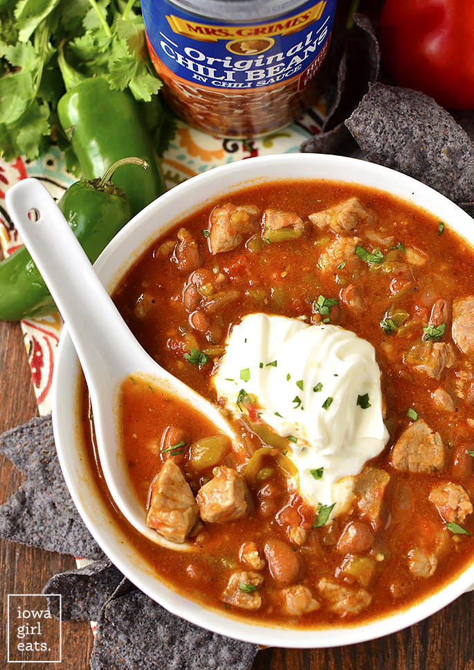 Fiesta Pork, Bean and Green Chili Chili has just the right amount of spice and sass. This filling chili recipe is perfect for cool nights or game day! | iowagirleats.com